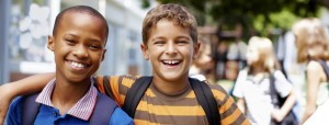 two school boys with backpacks smiling and happy