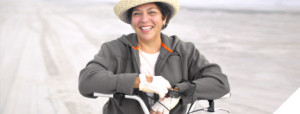 female on bicycle on the beach