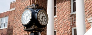 Old Clock outside brick building